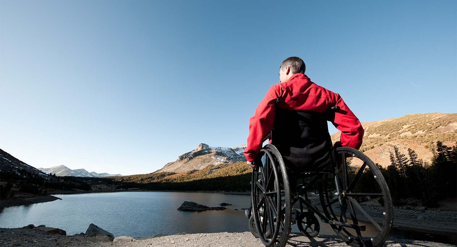 Spinal Injury Patient sits in Wheelchair overlooking lake
